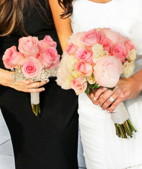 Bridal & 1 maid clutch bouquets of roses