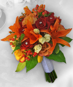 Clutch bouquet of lilies, roses, & hypericum.
